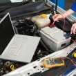 Mechanic using diagnostic tool on engine — Stock Photo #65562085