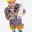 Frustrated handyman holding various tools — Stock Photo #65562531