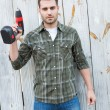Confident carpenter holding hand drill — Stock Photo #65562555