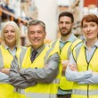 Smiling warehouse team with arms crossed — Stock Photo #65563519