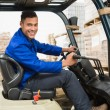 Driver operating forklift machine — Stock Photo #65563793