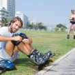 Fit man getting ready to roller blade — Stock Photo #65564561