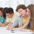 Fashion students taking notes in class — Stock Photo #65564667