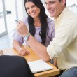 Smiling couple holding credit card to buy a car — Stock Photo #65564923
