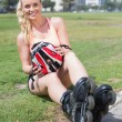 Fit blonde getting ready to roller blade — Stock Photo #65566277