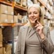 Smiling woman wearing a headset — Stock Photo #65566323