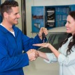 Mechanic giving keys to customer — Stock Photo #65566487