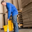 Focused man moping warehouse floor — Stock Photo #65566939