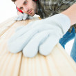 Worker measuring wooden plank — Stock Photo #65567181