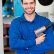 Mechanic holding a drill tool — Stock Photo #65567333