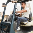 Driver operating forklift machine — Stock Photo #65567435