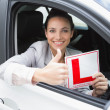Female driver giving thumbs up while holding her L sign  — Stock Photo #65567485