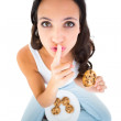 Pretty brunette eating plate of cookies — Stock Photo #65567697