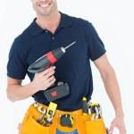 Carpenter holding portable drill machine — Stock Photo #65568709