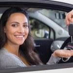 Salesman giving keys to woman — Stock Photo #65568845