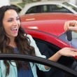 Excited woman receiving car key — Stock Photo #65568969