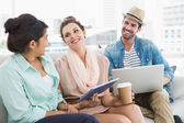 Colleagues chatting together on couch — Stock Photo