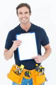 Carpenter showing blank clipboard — Stockfoto