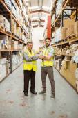 Warehouse team standing with arms crossed — Stock Photo