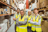 Warehouse team with arms crossed — Stock Photo