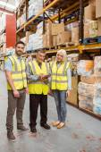 Warehouse team working together wile smiling at camera — Stock Photo