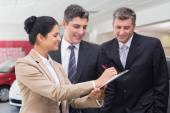 Business team working together on clipboard — Stock Photo