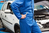 Mechanic with spanner by car — Stock Photo