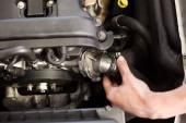 Mechanic working on an engine — Stock Photo