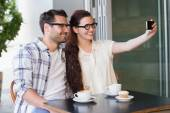 Couple on date taking selfie — Stock Photo