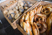 Basket filling with bread and pretzel — Stock Photo