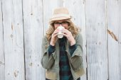 Blonde drinking from disposable cup — Stock Photo