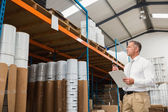 Warehouse manager checking his list — Foto de Stock
