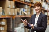 Smiling businesswoman scrolling on digital tablet — Stock Photo