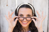 Pretty hipster smiling at camera — Stock Photo