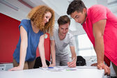 Smiling students working and taking notes together — Stock Photo