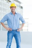 Happy architect with hands on hips — Stock Photo