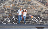 Attractive couple standing with bikes — Stock Photo