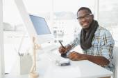 Happy businessman using digitizer at desk — Stock Photo