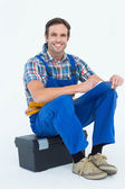 Plumber sitting on tool box — Photo