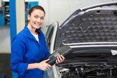 Smiling mechanic looking at camera — Стоковое фото