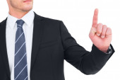 Unsmiling businessman pointing his finger — Stock Photo