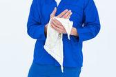 Mechanic wiping hand with napkin — Stock Photo