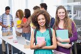 Students smiling at the camera — Stock Photo