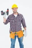 Male repairman holding drill machine — Stock Photo