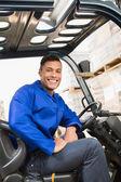 Driver operating forklift machine — Stock Photo