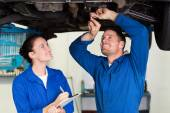 Team of mechanics working together — Fotografia Stock