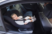 Cute baby in a car seat — Stock Photo