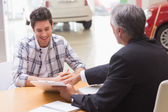Salesman showing client where to sign deal — Stock Photo