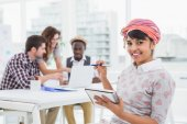 Businesswoman smiling and taking notes — Stock Photo