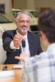 Salesman giving a customer car keys — Stock Photo